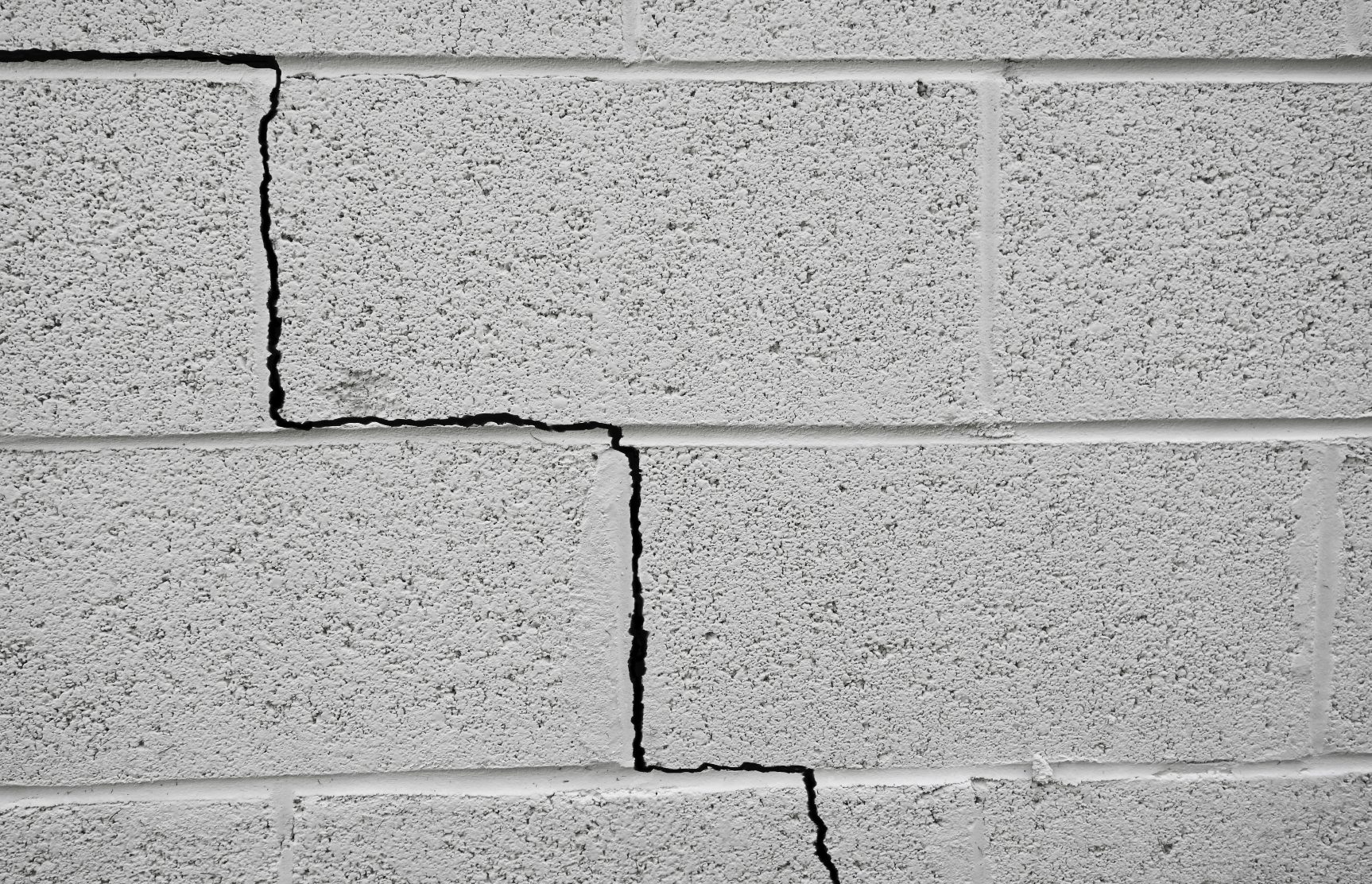 how to fix a crack in a concrete basement wall